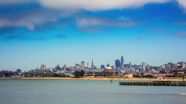 time lapse of san francisco skyline from bay - penisola video stock e b–roll