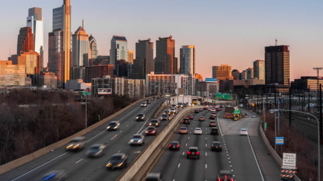 4K Time lapse of Schuylkill Expressway in rush hour at the evening time over the Philadelphia Pennsylvania cityscape background, United States, Business Architecture and Transportation concept Time lapse of Schuylkill Expressway in rush hour at the evening time over the Philadelphia Pennsylvania cityscape background, United States, Business Architecture and Transportation concept, 4k clip independence stock videos & royalty-free footage