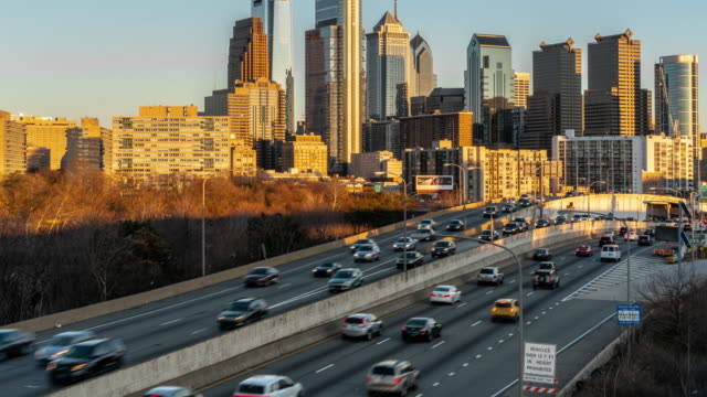 4K Time lapse of Schuylkill Expressway in rush hour at the evening time over the Philadelphia Pennsylvania cityscape background, United States, Business Architecture and Transportation concept
