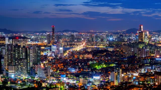 vídeos de stock e filmes b-roll de time lapse of seoul city skyline,south korea - seul