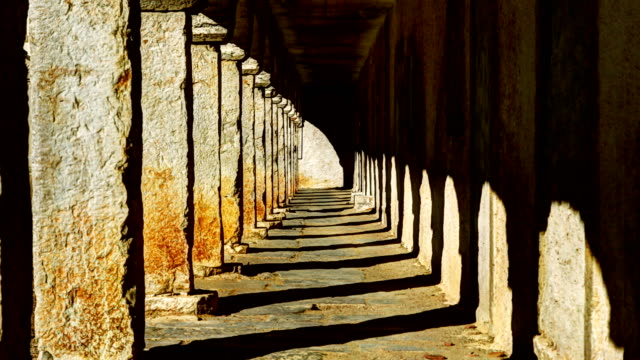 Time lapse of shadow in ancient arcade corridor Medieval corridor timelapse. architectural column stock videos & royalty-free footage