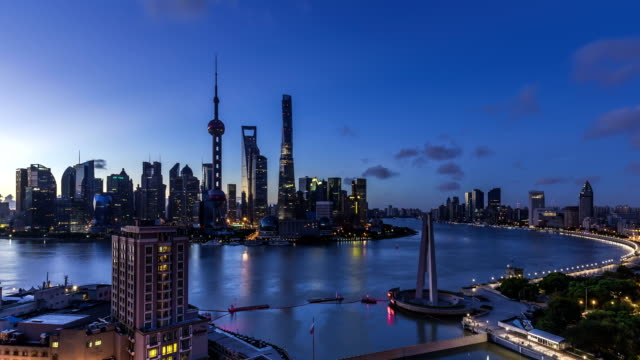 4K Time lapse of Shanghai skyline and cityscape at dawn