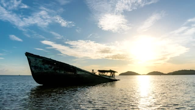 4-K Time lapse of shipwreck on beach in the andaman sea with beautiful sunrise or sunset in phuket thailand video