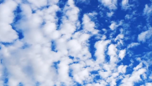 Time lapse of slow moving scattered clouds Time lapse footage of slow moving white scattered clouds with blue summer sky hound stock videos & royalty-free footage