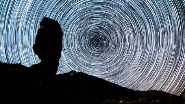 Time lapse of star trails moving over Teide volcano and Los Roques de Garcia rocks, Teide National Park, Tenerife, Canary islands, Spain. Startrails timelapse over Teide volcano, Tenerife rock formations stock videos & royalty-free footage