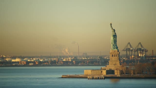 Time Lapse of Statue of Liberty in the New York Harbor with Shipping Trucks in the Port of New York and New Jersey