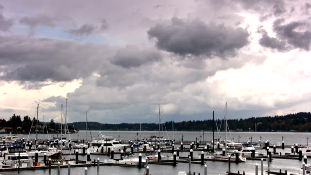 Time lapse of storm clouds rolling over marina. video