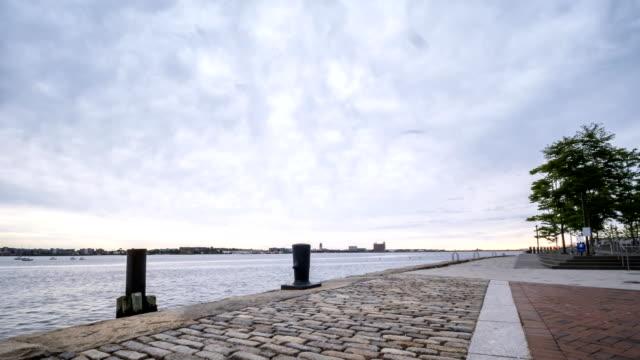 time lapse of stormy skies from the boston harbor - пешеходная дорожка путь сообщения стоковые видео и кадры b-roll