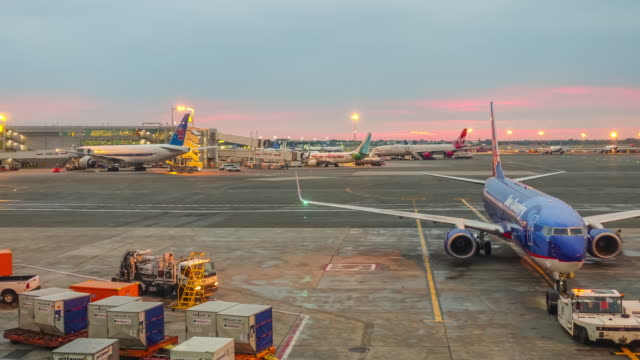 Time lapse of sunrise and busy airport at JFK Time lapse of sunrise and busy airport at JFK in New York City, USA airport runway stock videos & royalty-free footage