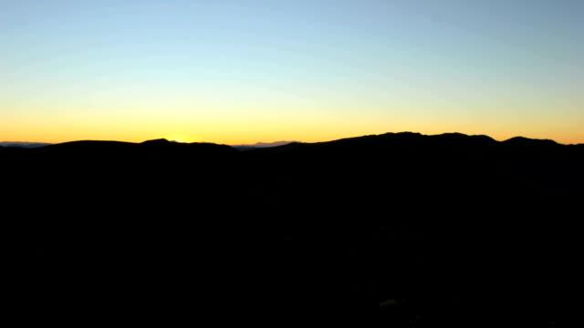 Time Lapse of Sunrise over the Desert Hills video