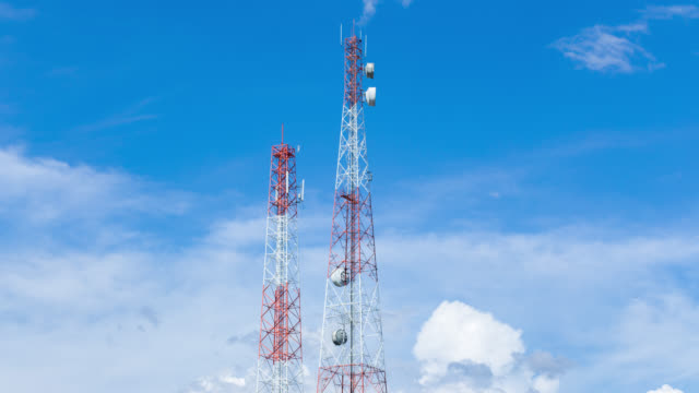 Time lapse of telecom pole with clouds move and blue sky background video