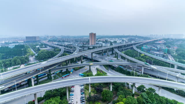 Time lapse of the busy interchange traffic in city from day to night video