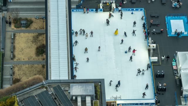 4K Time lapse of The ice skating rink with crowd people at Tokyo Skytree Town Ice Skating Park in Tokyo city, Japan. Japanese culture and activities concept