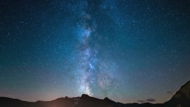 Time Lapse of the Milky way rotating over the Alps video