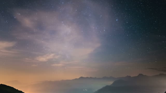 Time Lapse of the Milky Way rotating over the Alps with fog video