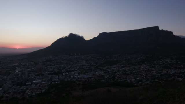 Time lapse of the sunrise and Table mountain Cape Town, South Africa Time lapse of the sunrise and Table mountain Cape Town, South Africa table mountain national park stock videos & royalty-free footage