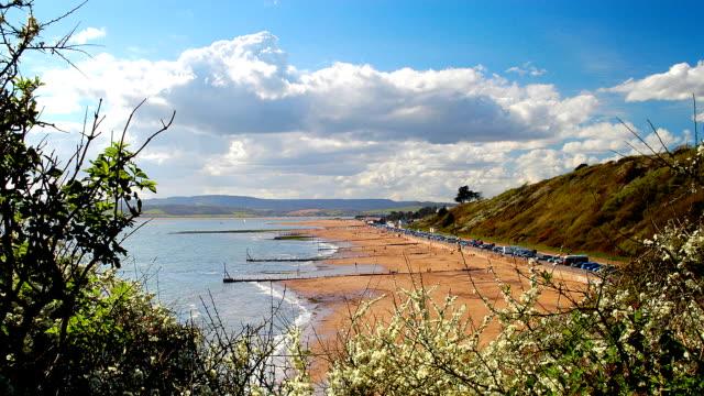 vídeos y material grabado en eventos de stock de time lapse of the tide creciente, exmouth reino unido - marea