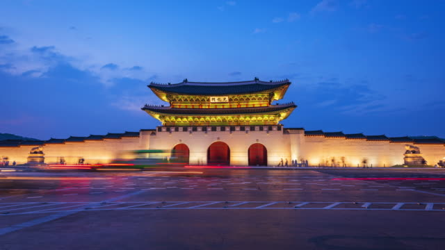 Time lapse of tourists swarming through Gyeongbokgung Palace in Seoul City,South Korea.Zoom Time lapse of tourists swarming through Gyeongbokgung Palace in Seoul City,South Korea.Zoom seoul stock videos & royalty-free footage