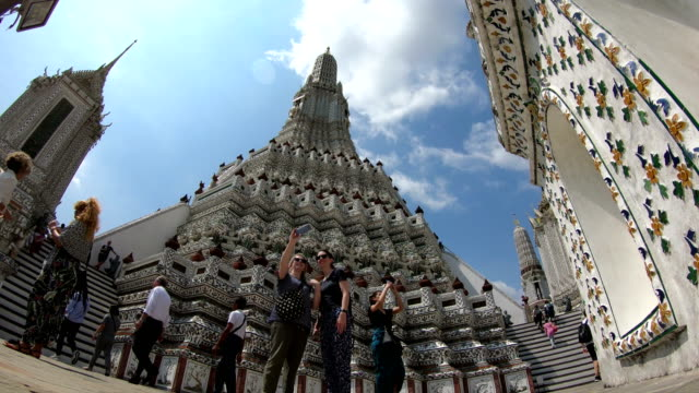 Time lapse of tourists walking around Wat Arun, Bangkok, Thailand Bangkok, Thailand - March 5, 2018 : Time lapse of tourists walking around Wat Arun, Bangkok, Thailand. southeast stock videos & royalty-free footage