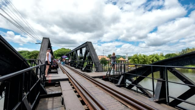 Time lapse of Tourists walking on ancient railway track of history world war II in river kwai video