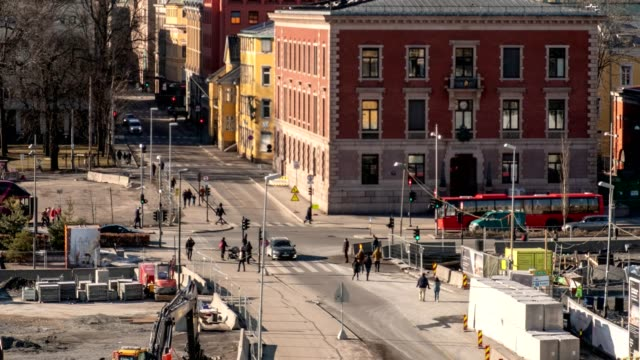 Time lapse of Traffic in beautiful downtown with people walking crossroad at Oslo city