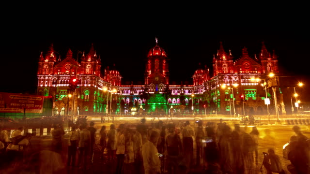 time lapse of traffic moving in front of  Chhatrapati Shivaji Terminus (CST)  formerly known as Victoria Terminus  (UNESCO World Heritage building)is being lit up with Indian tricolour, Mumbai, India video