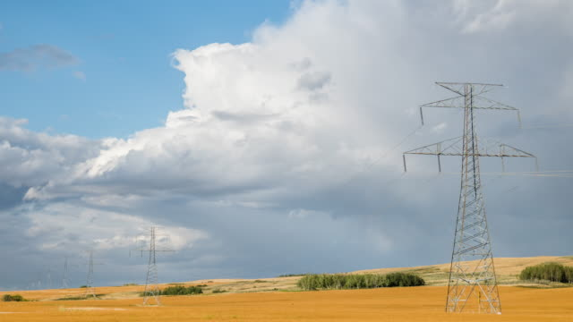 time lapse of transmission tower beautiful clouds in the background