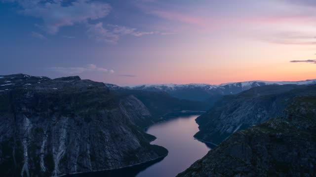 Time lapse of Trolltunga mountain cliff at sunset, most famous mountain hiking route in Norway in summer season, Norway, Scandinavia