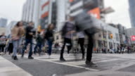 istock Time lapse of vehicular traffic and pedestrians at Downtown Toronto intersection 1216055940