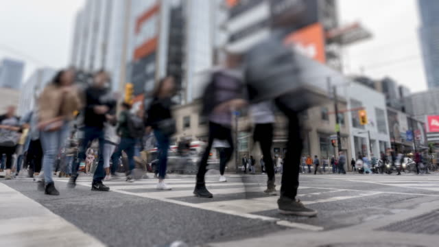Video Time lapse of vehicular traffic and pedestrians at Downtown Toronto intersection