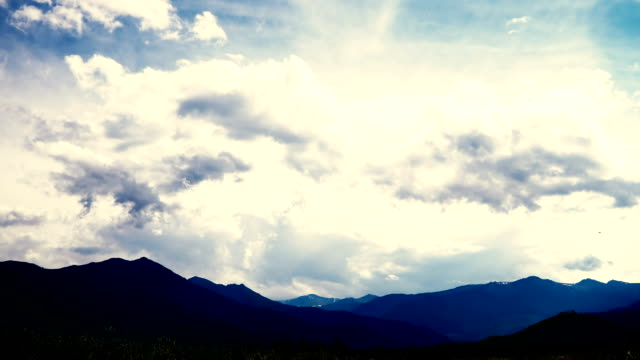 Time lapse of wickedly intense clouds roiling and flowing over peaks video