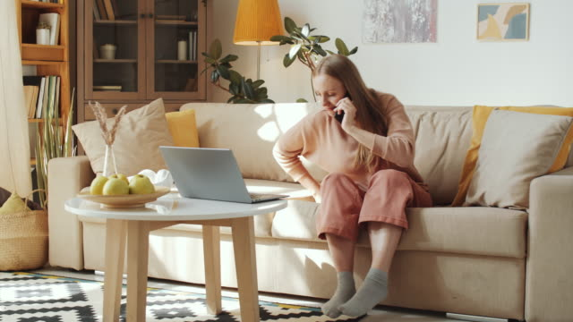time lapse of woman spending day at home during lockdown - movimento rapido video stock e b–roll