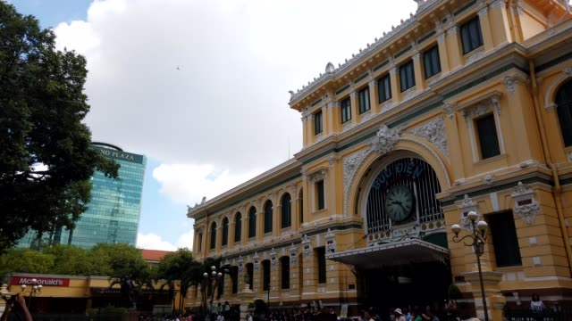 Time lapse off Saigon Central Post Office designed by Gustave Eiffel Time lapse of The Ho Chi Minh City Post Office, or the Saigon Central Post Office. Local people and tourist take sightseeing at Post Office french architecture stock videos & royalty-free footage