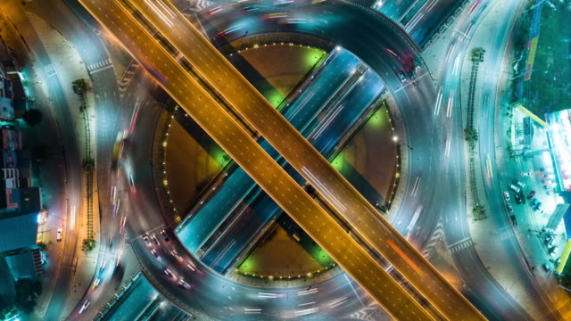 4k time lapse or hyper lapse zoom out : aerial view network or intersection of highway road for transportation or distribution concept background. - industria edile video stock e b–roll