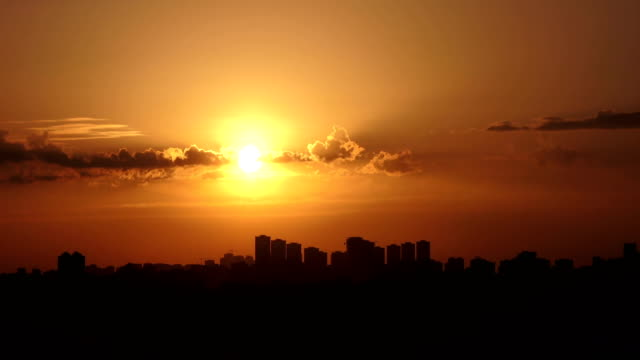 Time lapse panoramic sunset on the cloudy sky over city, Turkey - video