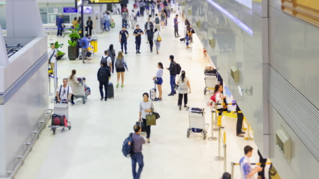 4K time lapse :Passengers and world travelers check in at airport.zoom out styles. video