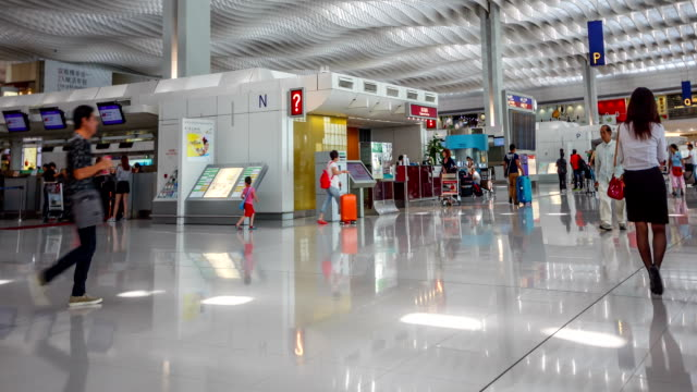Time lapse passengers arrive at the terminal of Hong Kong International Airport  , China video