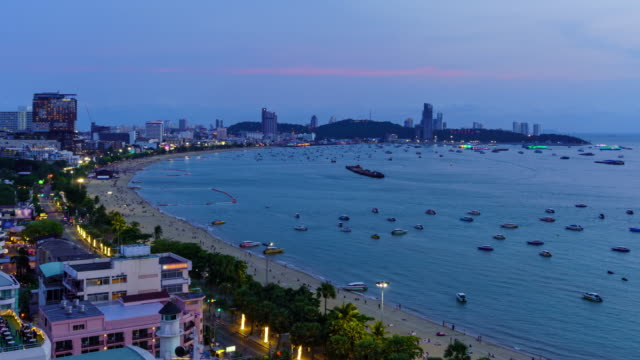 Time Lapse: Pattaya bay beach bay and city, day to night, Chonburi, Thailand Time Lapse: Pattaya bay beach bay and city, day to night, Chonburi, Thailand pattaya stock videos & royalty-free footage