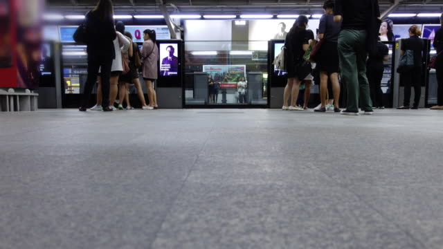 Time lapse : people waiting in line at train station video