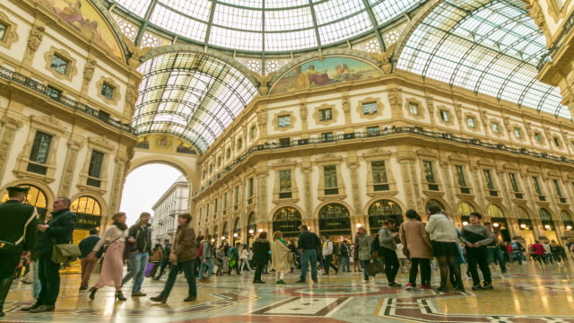 Time Lapse: People walk on galleria Vittorio Emanuele II seen from above of the most popular shopping areas in Milan. video