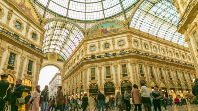 time lapse: people walk on galleria vittorio emanuele ii seen from above of the most popular shopping areas in milan. - alta moda italy video stock e b–roll