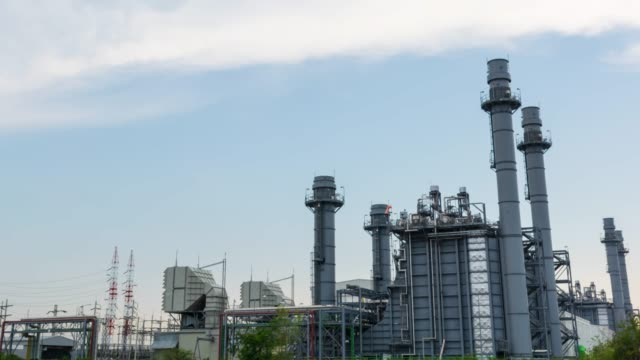 Time lapse Power plant for Industrial, Energy power station area at blue sky with clouds background. industry Time lapse Power plant for Industrial, Energy power station area at blue sky with clouds background. industry generation x stock videos & royalty-free footage