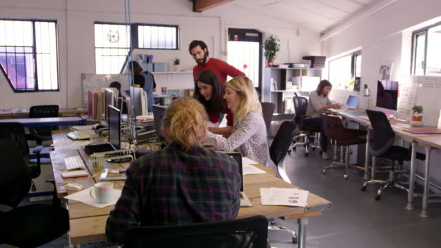 time lapse sequence of busy design office shot on r3d - hart arbeiten stock-videos und b-roll-filmmaterial
