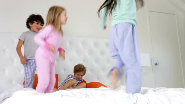 Time Lapse Sequence Of Four Children Playing On Bed video