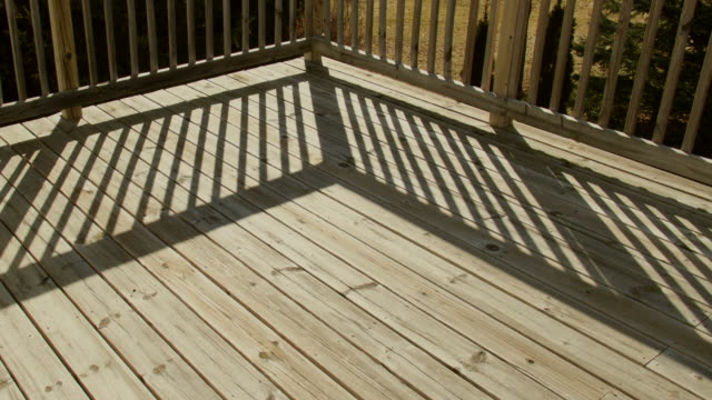 Time Lapse Shadows Moving Across Wooden Deck in Back Yard.