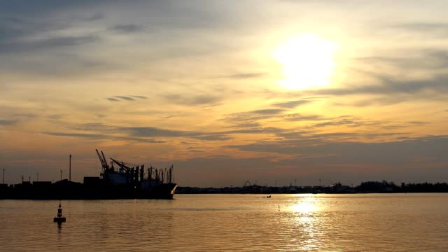 Time Lapse - Shipping through sea ports and sea view in the evening , Sunset shines with water reflection video