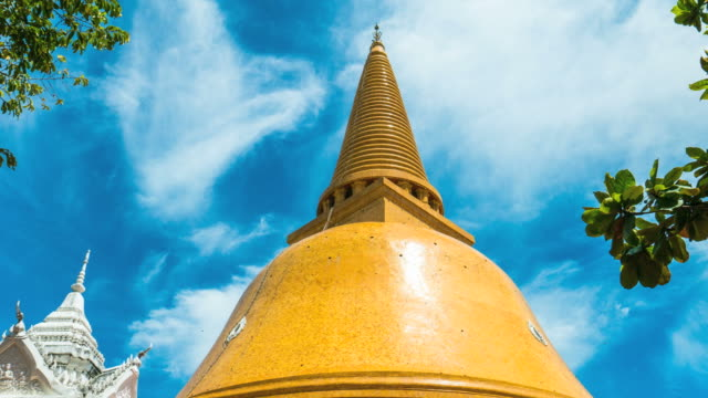 Time Lapse Shot of Amazing Large Golden Pagoda with Blue Sky Time Lapse Shot of Amazing Large Golden Pagoda with Blue Sky, Phra Pathom Chedi , Nakhon Pathom , Thailand. Pan shot sukhothai stock videos & royalty-free footage