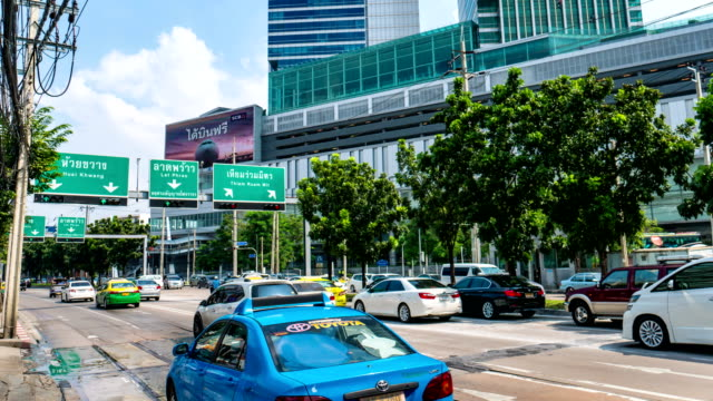 Time Lapse Shot of Busy Traffic in Financial Area, Bangkok, Thailand. Panning shot video