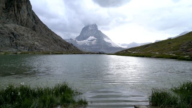 Time lapse shot of clouds moving over Matterhorn peak in the heart of the Swiss Alps video