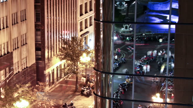 Time lapse shot of downtown Indianapolis at night against a mirrored building video